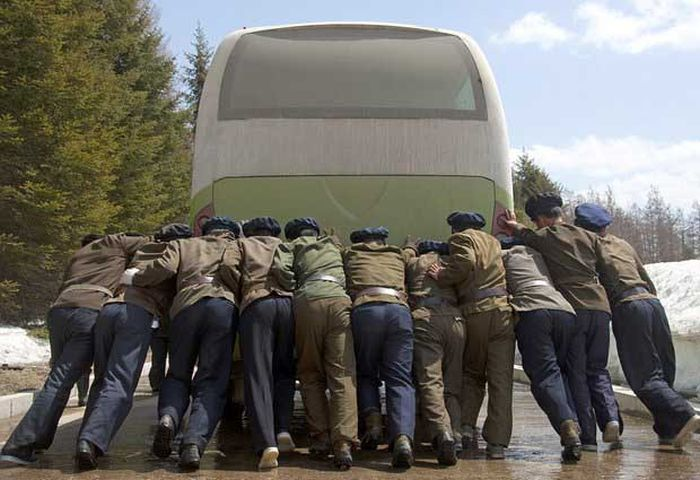 North Korea Rare Deleted Photos - army pushes bus