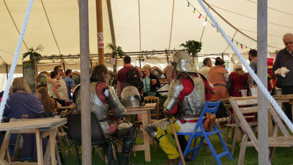 Herstmonceux Medieval Festival - knight on blue chair