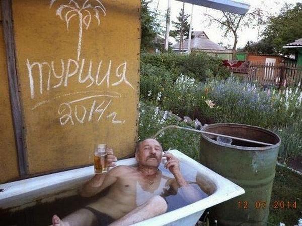 Russian guy smoking drinking bath outside