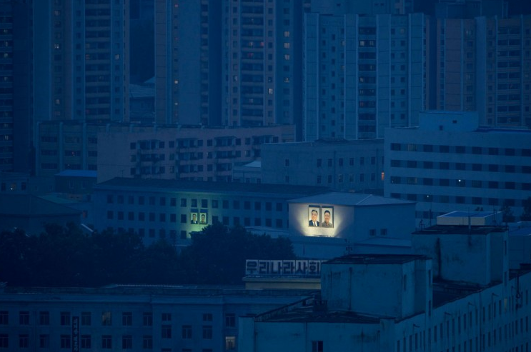 North Korea - Portraits Lit At Night