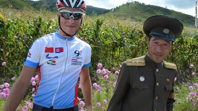 North Korea - Swedish racer Christian Bertilsson with North Korean police