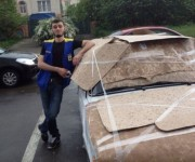 PHOTOS: People Attempting To Protect Their Cars From Hail