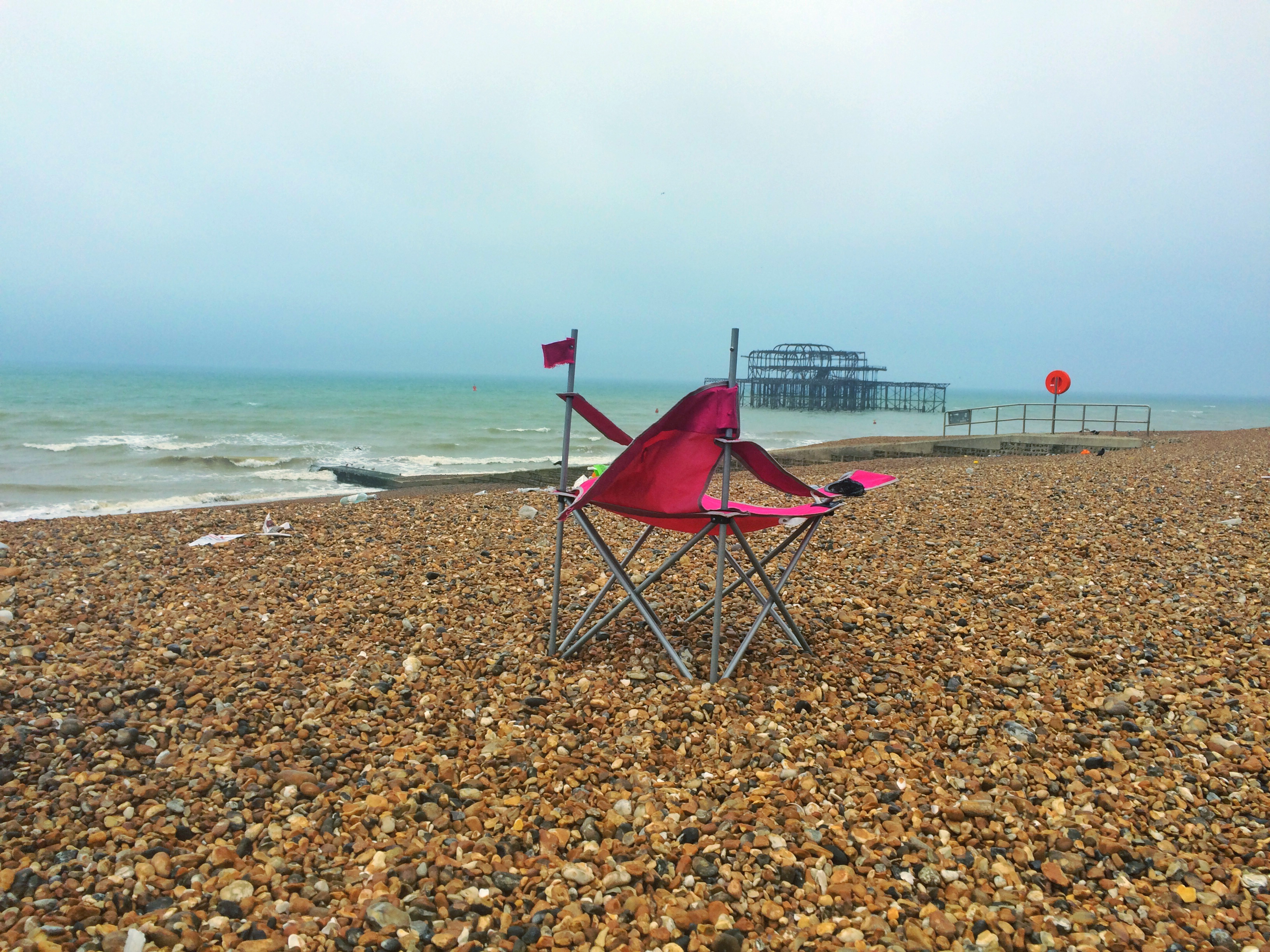BRIGHTON PRIDE 2016 AFTERMATH - pink chair and west pier