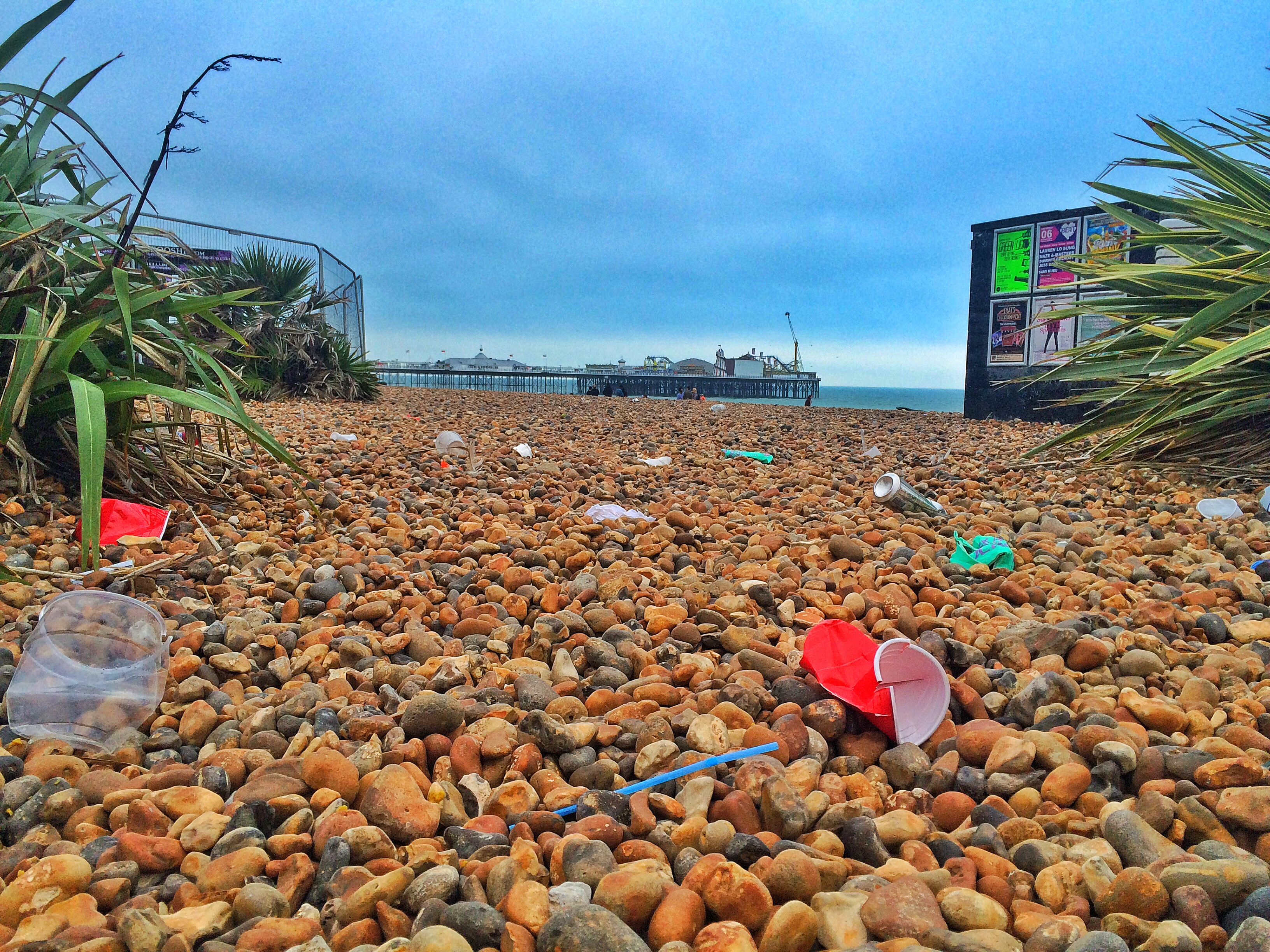 BRIGHTON PRIDE AFTERMATH 2016 - LITTER ON BEACH BY PIER