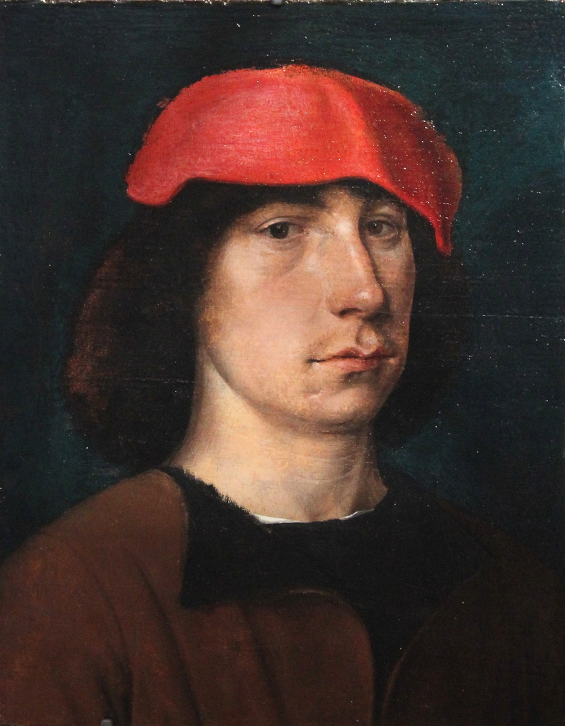 Portrait of a young man with red cap