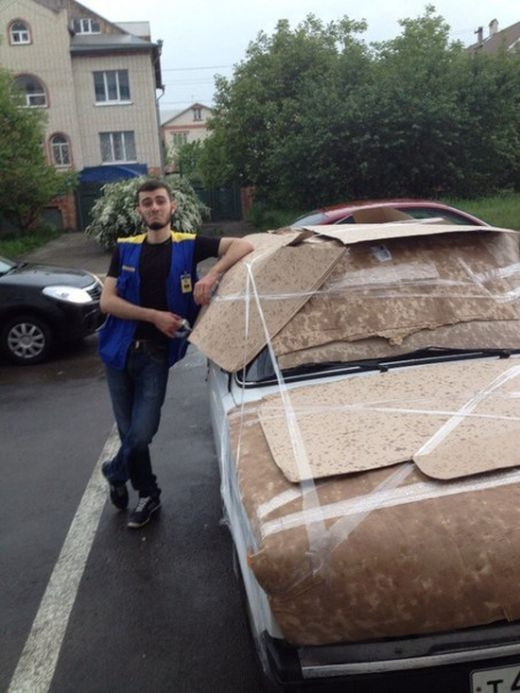 PHOTOS People Attempting To Protect Their Cars From Hail